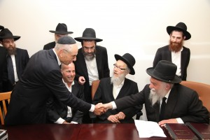 Harav Shlomo Miller welcoming Mr. Joel Thea of Zman Technologies. Seated on Rav Miller's right is Mr. William Thea and Harav Asher Chaim Lieberman, Dayan, Lakewood.